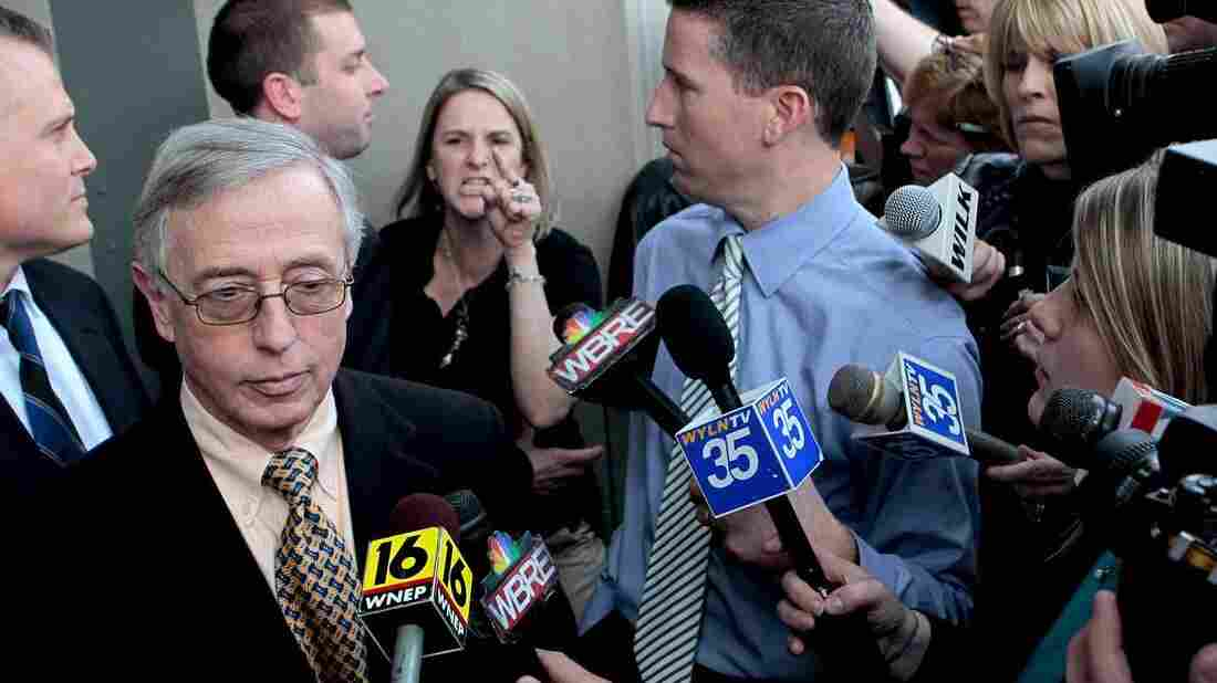 """Sandy Fonzo confronts Judge Mark A. Chiavarella on the courthouse steps after he was convicted in the """"Kids for Cash"""" scandal in 2011. Fonzo's son, who eventually committed suicide, was among thousands Chiavarella had sent to a juvenile detention facility from which he'd received a """"finder's fee."""""""
