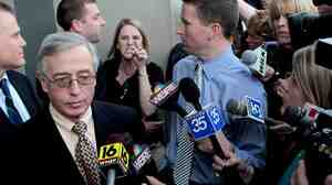 "Sandy Fonzo confronts Judge Mark A. Chiavarella on the courthouse steps after he was convicted in the ""Kids for Cash"" scandal in 2011. Fonzo's son, who eventually committed suicide, was among thousands Chiavarella had sent to a juvenile detention facility from which he'd received a ""finder's fee."""