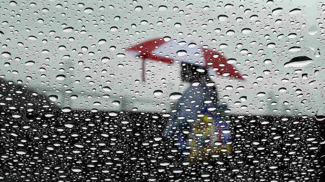 Raindrops on a windshield blurred the view of a woman Wednesday in San Francisco. California, which is suffering through a drought, is getting some much-needed precipitation this week.