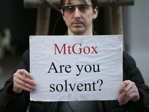 Apparently Not: A protester holds a placard Tuesday during a demonstration in front of the offices of Mt. Gox, a Bitcoin exchange in Tokyo. On Friday, Mt. Gox filed for bankruptcy protection.