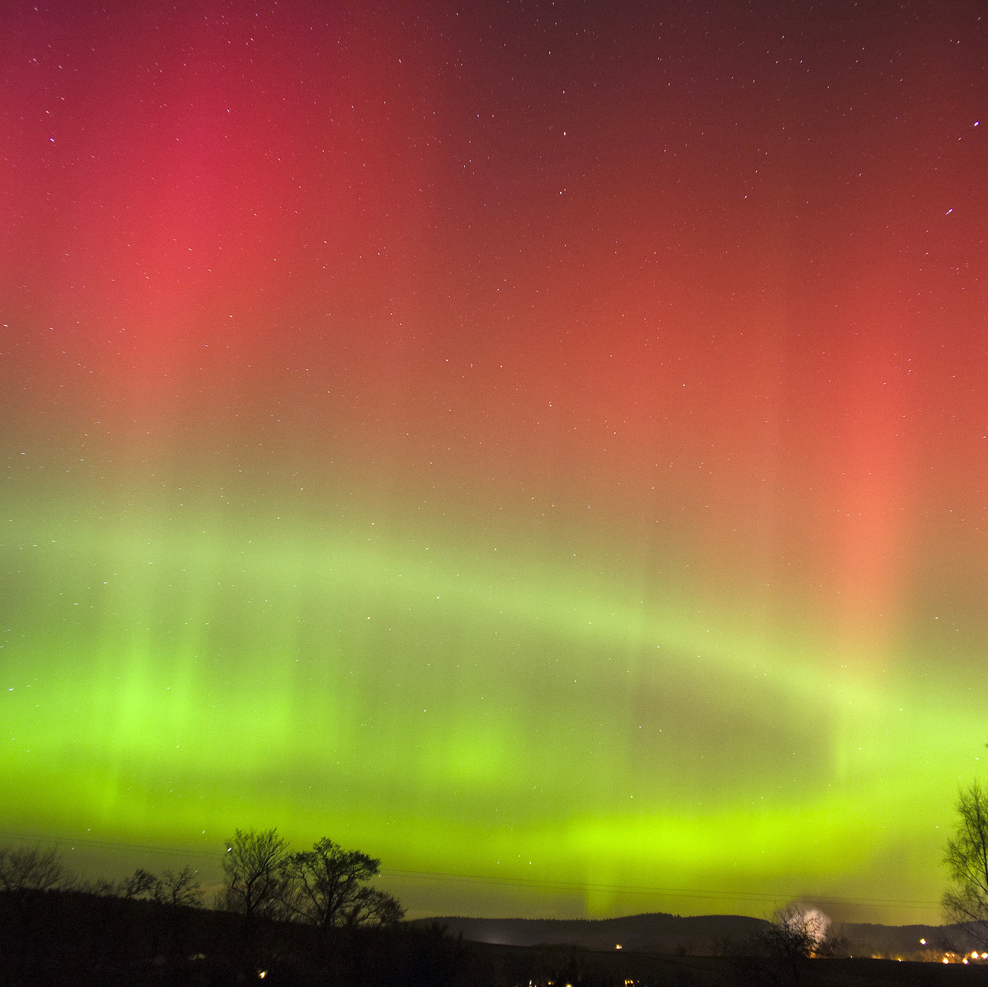 A view of the Northern Lights as seen from Crooktree in Aberdeenshire, Scotland, Thursday. The light show occurs when highly charged electrons from solar wind interact with Earth's atmosphere.