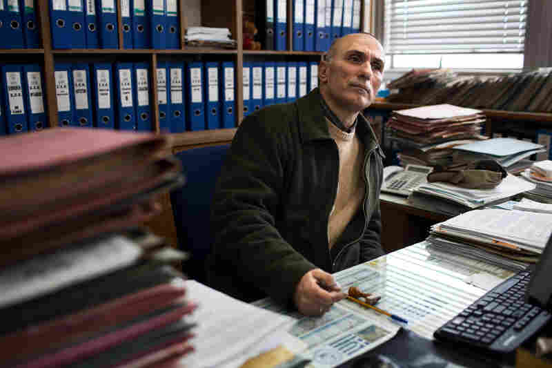Aivatzidis at his desk at Hellenic Shipyards, where he was a human resources manager. For Aivatzidis and Tsitoura, providing for their children is a communal effort. They receive help from both their parents, in particular the pension of Nikos' father, sharing meals and other expenses, and occasionally from friends who are faring better.