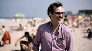 Beautiful Music Together: Joaquin Phoenix takes a walk on the beach with his girlfriend the Operating System in the Oscar-nominated film Her.