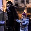 A woman walks with a child in Kiev's Independence square.