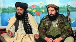Shahidullah Shahid (right), spokesman of banned Tehrik-e-Taliban Pakistan sits with a local commander Azam Tariq  as they speak to journalists at an undisclosed location near the Afghan border last month.