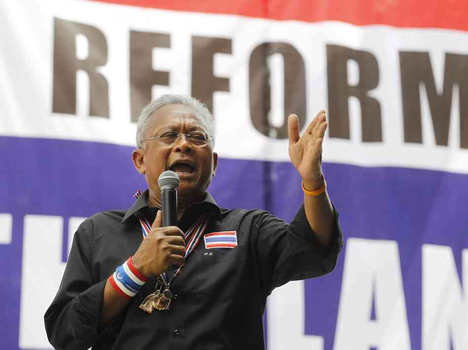 Thai anti-government protesters leader Suthep Thaugsuban speaks to his supporters during a rally at Silom intersections in Bangkok on Friday.