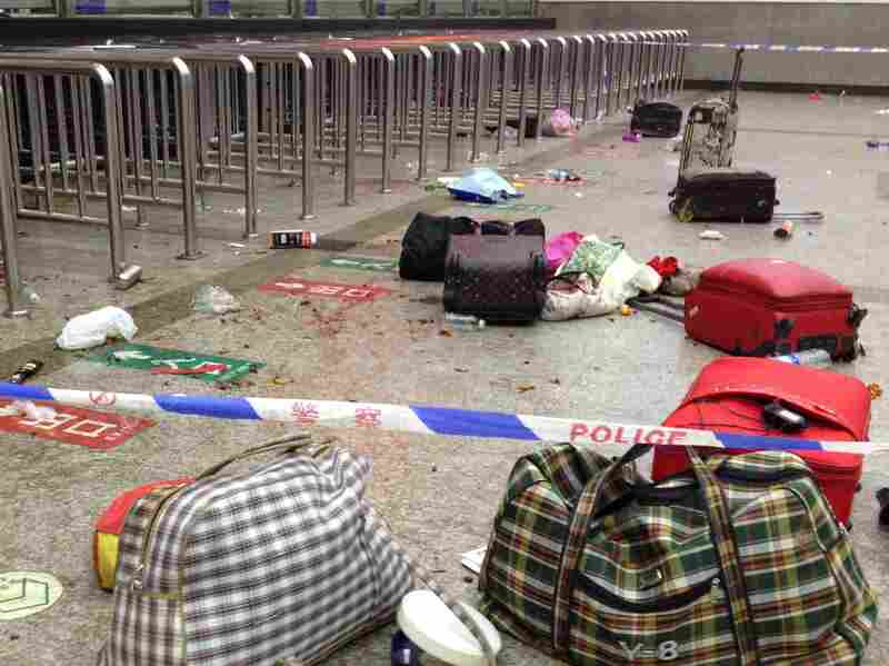 Picture taken by mobile phone on Saturday shows luggage scattered inside the Kunming Railway Station in Kunming, capital of southwest China's Yunnan Province.