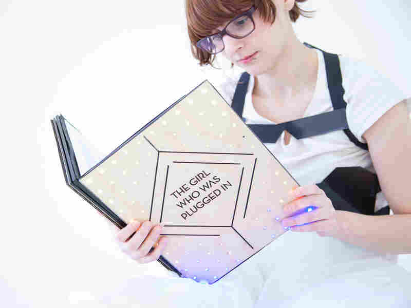 MIT students created a book that interacts with a vest for a multi-sensory experience.
