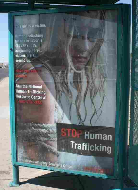 An ad on a bus shelter in New Mexico is part of an ongoing effort to educate law enforcement and the public about human trafficking. The Justice Department estimates that each year at least 200,000 children are trafficked for sex in the U.S.