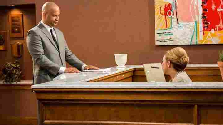 Mad Black Men's protagonist, Ron Rapper, gets a skeptical look from the secretary on his first day in the office.