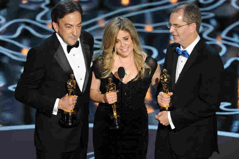 Producer Peter Del Vecho (left) and directors Jennifer Lee and Chris Buck won Oscars for their animated feature Frozen.