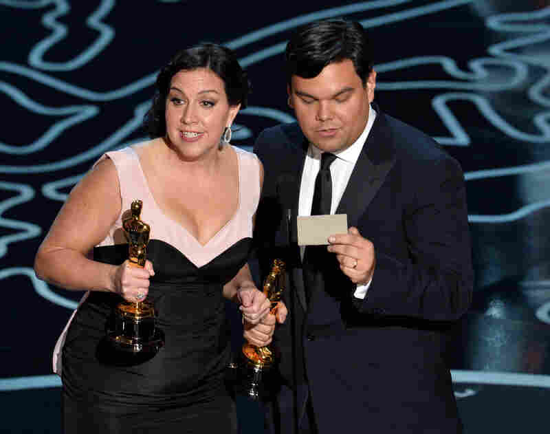 "Songwriters Kristen Anderson-Lopez (left) and Robert Lopez won the Original Song award for ""Let It Go,"" from Disney's Frozen, and accepted with a charming rhymed speech. With his win, Robert Lopez joined the EGOT club — becoming the 12th person to win an Emmy, a Grammy, an Oscar and a Tony."
