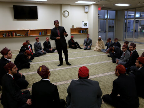 A member of Alpha Lambda Mu addresses his brothers during a fraternity meeting at the Islamic Association-Collin County masjid in Plano, Texas.