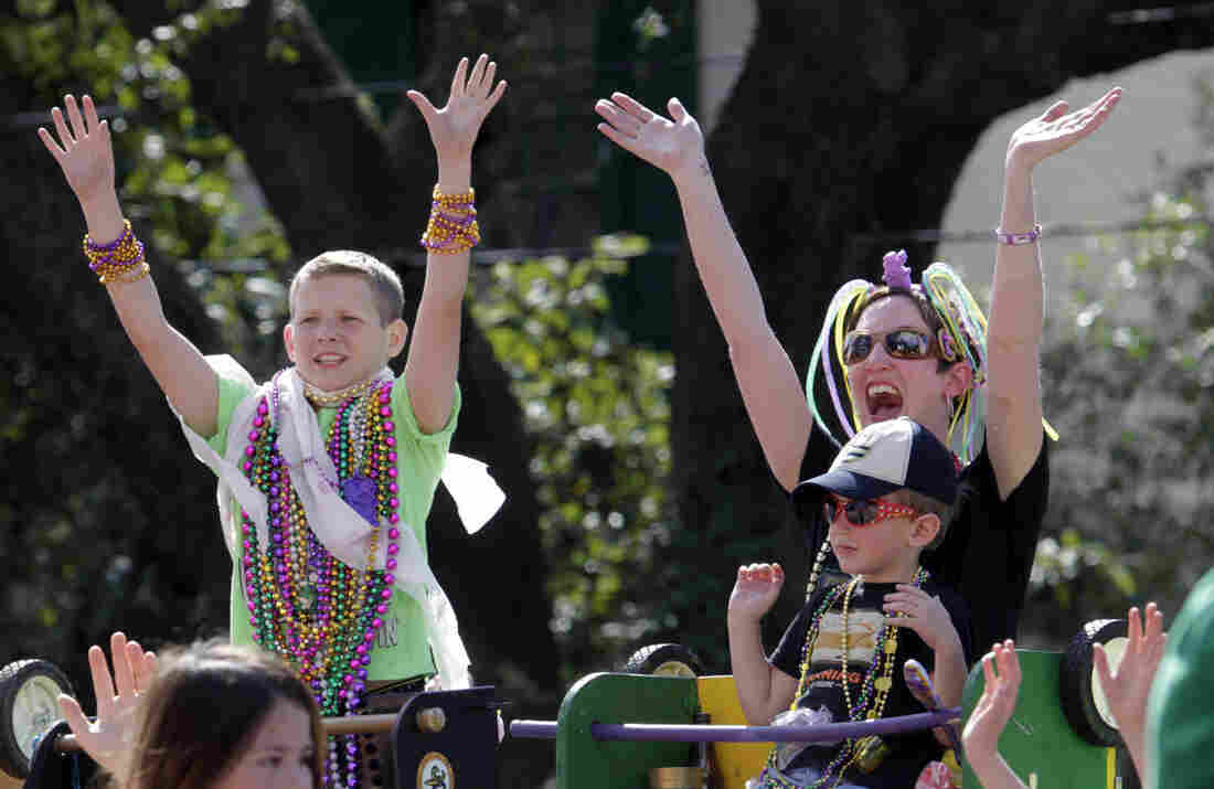 Paradegoers yell for beads from float-riders in the Tucks Mardi Gras parade in New Orleans on Saturday. Mardi Gras is the city's biggest holiday, starting two