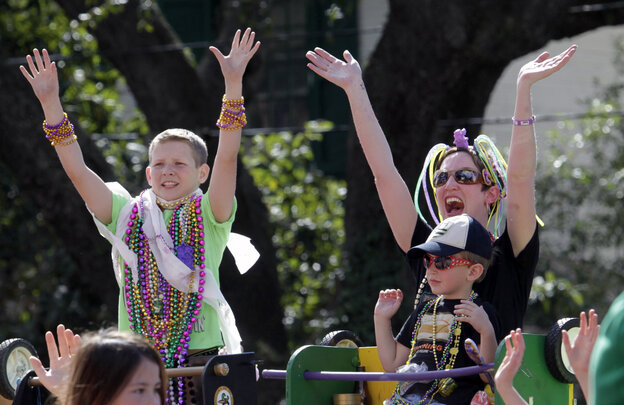 Paradegoers yell for beads from float-riders in the Tucks Mardi Gras parade in New Orleans on Saturday. Mardi Gras is the city's biggest holiday, starting two weeks before Fat Tuesday and culminating with a long weekend crammed with parades. But there's a family-friendly side to this notoriously drunken party.