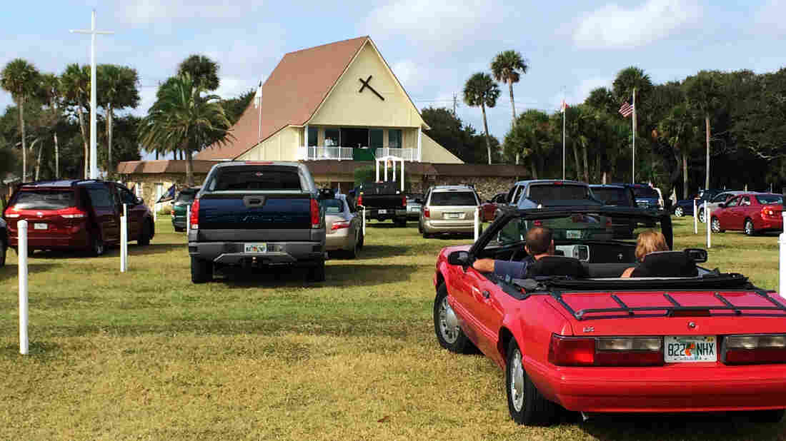 Sun, surf and sermons: At the Daytona Beach Drive In Christian Church in Florida, parishioners attend services by parking their cars in a grassy lot.