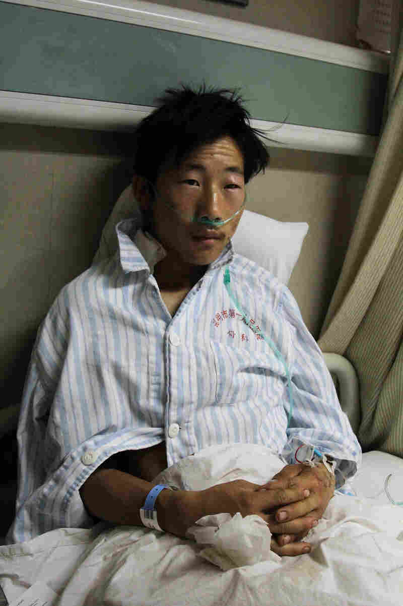 """Xia Fanchao, 18, said a woman in a long black dress and a black veil stabbed him in the neck. """"It felt like I was being electrocuted,"""" he said."""