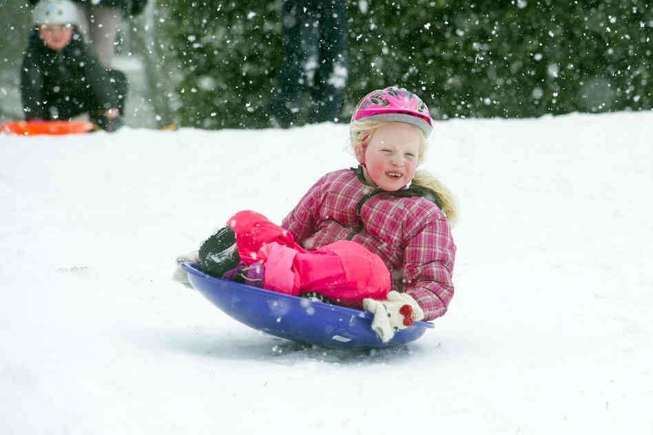 """Blair Todd, 6, sleds down a hill in Alexandria, Va. The National Weather Service predicted heavy snow """"from the Ohio Valley into the Mid-Atlantic through Monday night, making for hazardous travel conditions."""""""