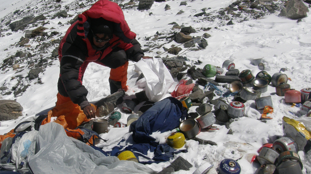 A Nepalese Sherpa collecting garbage, left by climbers, at an altitude of 26,250 feet during a special Everest clean-up expedition. (AFP/Getty Images)