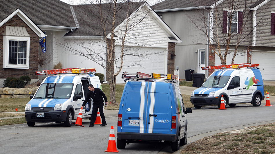 Google Fiber installers work in Kansas City, Kan., in March 2013. Cities that aren't being considered for Google's high-speed Internet, like Louisville, Ky., are trying to find ways to bring in a similar product.