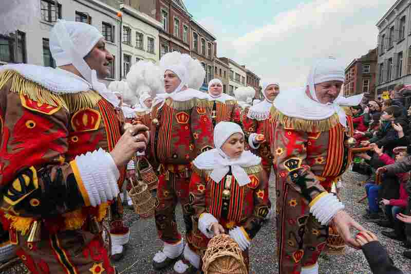 Participants, known as Gilles, wear traditional costumes and hats made of white ostrich feathers during the carnival in the streets of Binche, Belgium. The Carnival de Binche has been proclaimed a Masterpiece of the Oral and Intangible Heritage of Humanity by UNESCO for the past ten years.