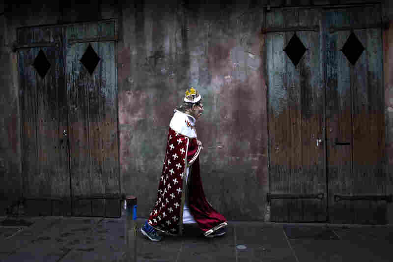 A reveler parades through the French Quarter in New Orleans.