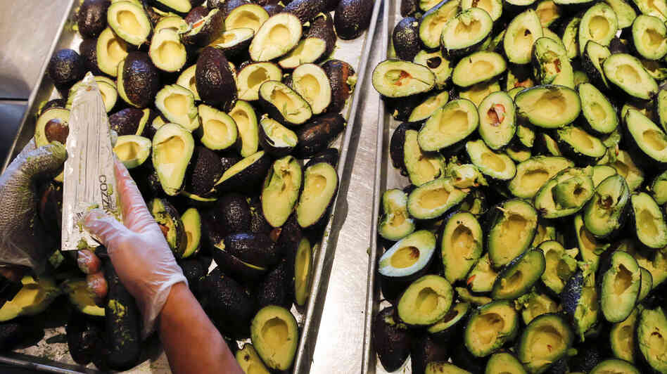 An employee prepares to make fresh guacamole at a Chipotle restaurant in Hollywood, Calif.