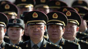Delegates from China's People's Liberation Army (PLA) march from Tiananmen Square to the Great Hall of the People to attend sessions of National People's Congress and Chinese People's Political Consultative Conference Tuesday in Beijing.