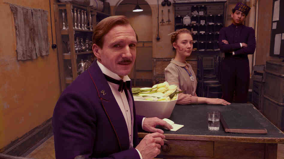 Gustave H. (Ralph Fiennes, with Saoirse Ronan and Tony Revolori) is a hotel concierge in an Eastern Europe falling under Hitler's shadow — a man pining for the Old World sensibility that's fading all around him.