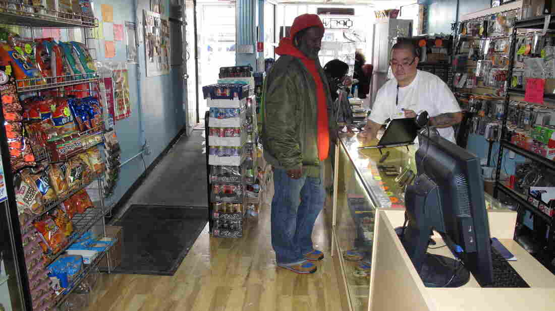 Communications store owner Donny Seto (right) says other business owners shouldn't be so hesitant to set up in the Congress Heights neighborhood of Washington, D.C.