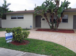 ReBOUND Residential in Florida has bought multiple properties like this one, a formerly bank-owned home in Sunrise, Fla., as investment properties. The houses are now bringing steady returns as rentals.