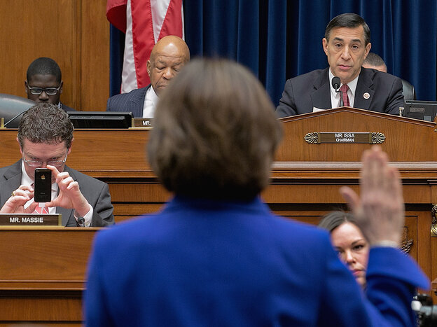 Former IRS official Lois Lerner raises her hand as she's sworn in Wednesday at the start of a House Oversight & Government Reform Committee hearing. She declined to answer questions posed by Chairman Darrell Issa, invoking her Fifth Amendment right.