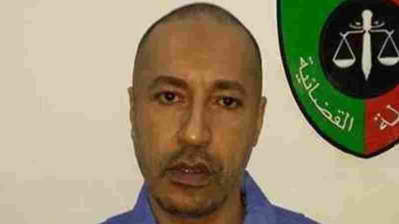 Saadi Gadhafi, son of Moammar Gadhafi, looks on inside a prison in Tripoli in this handout after his extradition from Niger on Thursday.