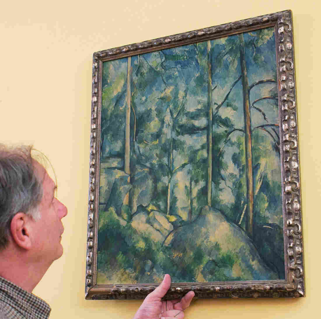 Robert Krulwich grabs a version of Cézanne's Pines and Rocks -- and it reaches for him, too.