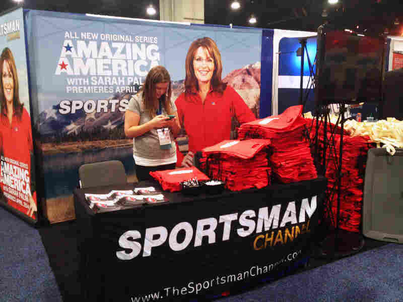 A booth at CPAC promotes Sarah Palin's latest cable television show, Amazing America.