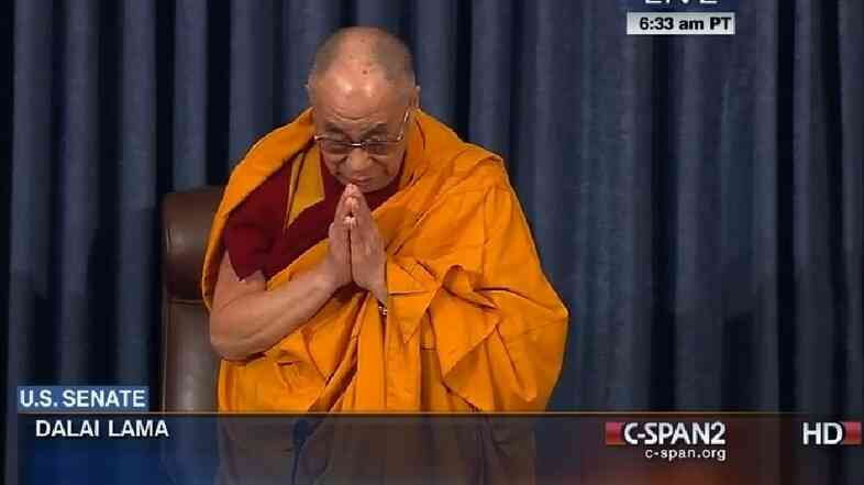 The Dalai Lama delivers the opening prayer Thursday at the U.S. Senate.