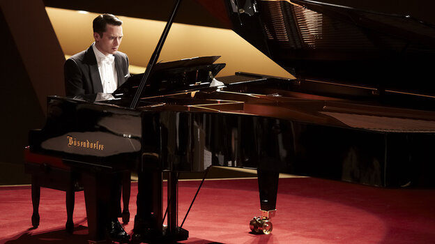 Tom Selznick (Elijah Wood) is a renowned concert pianist who's literally under the gun in Grand Piano, a Hitchcock-style thriller that plays out in real time.