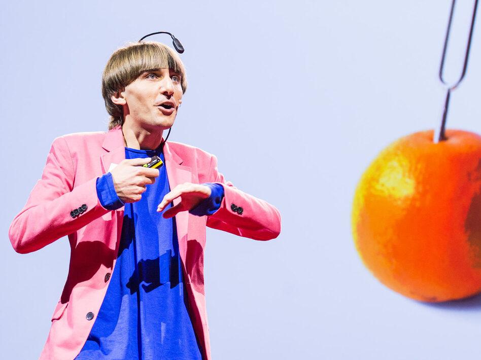 Artist Neil Harbisson speaking at TED Global. ( James Duncan Davidson/TED)