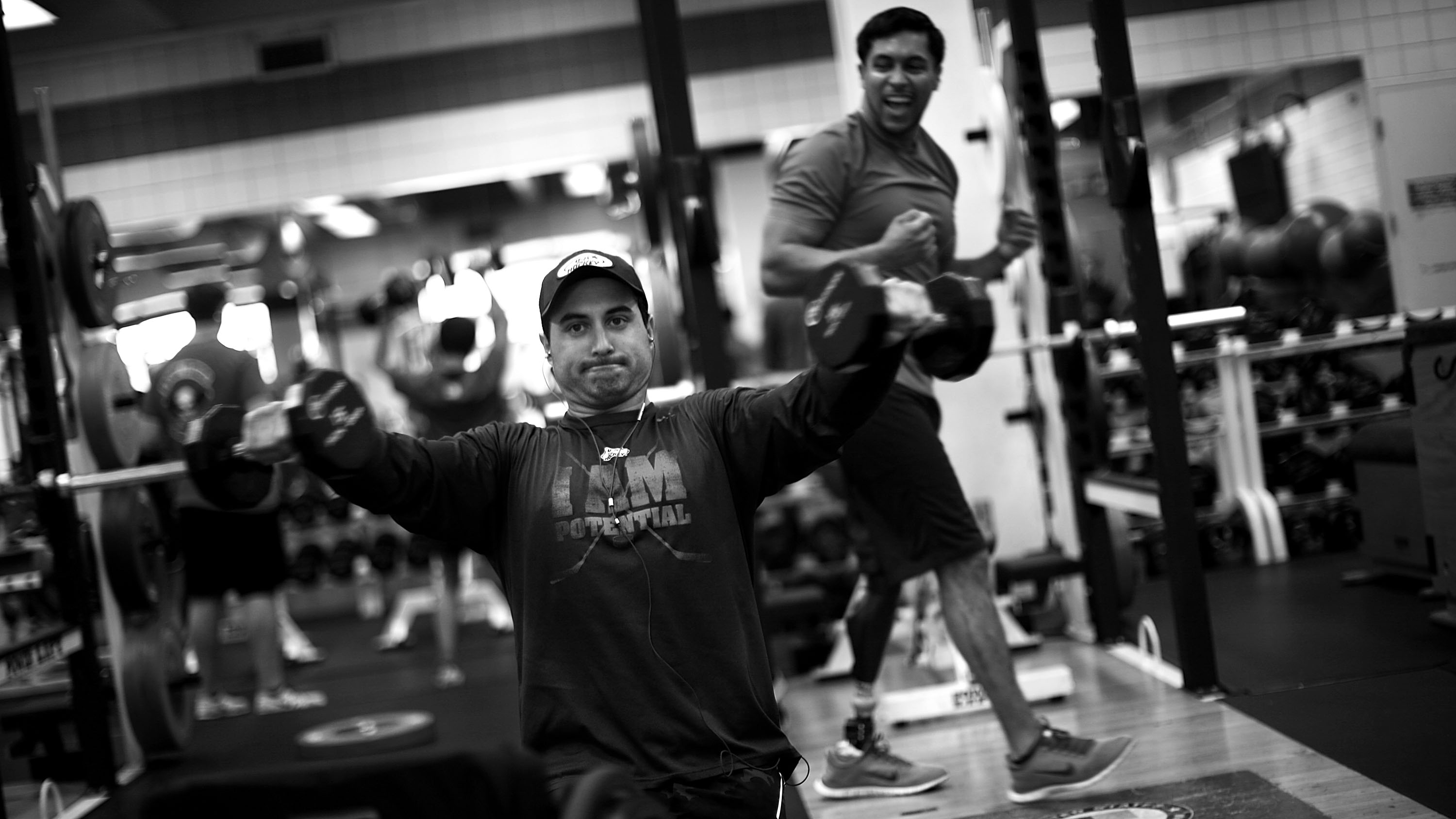 Josh Sweeney (center) and Rico Roman work out together. Roman, a veteran who lost a leg during his third deployment to Iraq in 2007, introduced Sweeney to the sport.