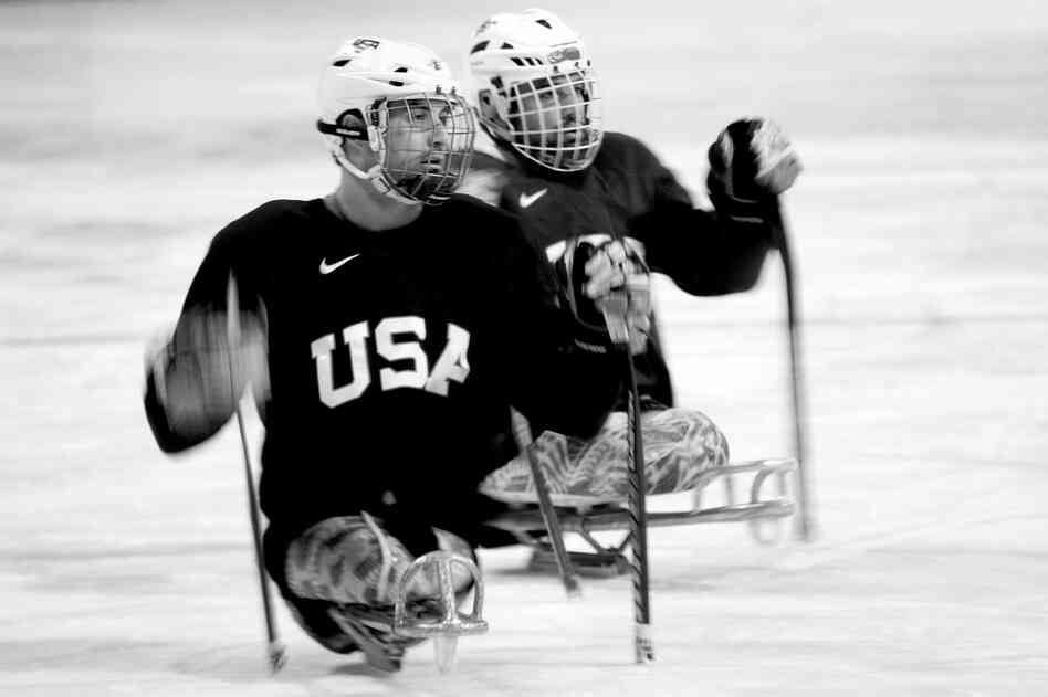 Josh Sweeney lost both of his legs to a bomb in Afghanistan, where he served as a Marine in 2009. He is now competing with the U.S. Men's Sled Hockey team at the Paralympics in Sochi, Russia.