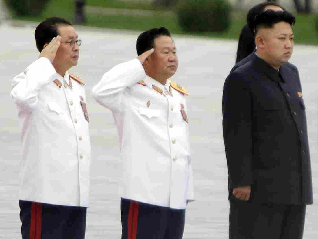 In a photograph taken in July, North Korean leader Kim Jong Un (from right) stands with Choe Ryong Hae and Jang Song Thaek, Kim's uncle.
