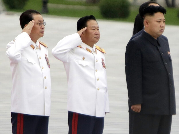 In a photograph taken in July, North Korean leader Kim Jong Un (from right) stands with Choe Ryong Hae and Jang Song Th
