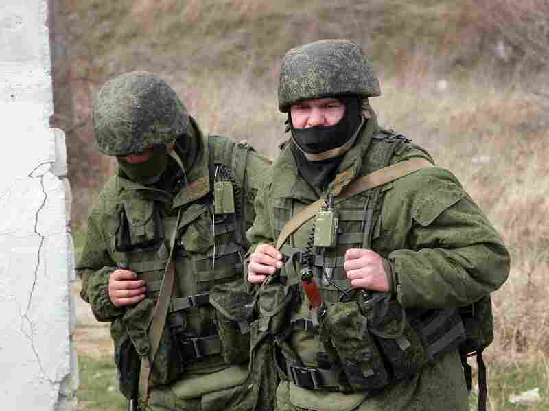 Unidentified armed men in military uniforms block a Ukrainian military base in the village of Perevalnoye, outside Simferopol, Ukraine, on Thursday. Similar pro-Russian forces forced a brief standoff at the missile defense base in Sevastopol on Friday.