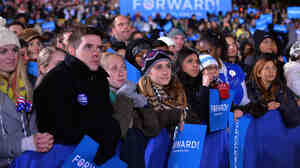 Supporters listen to President Obama during a campaign rally at Jiffy Lube Live in Bristow, Va., on Nov. 3, 2012.