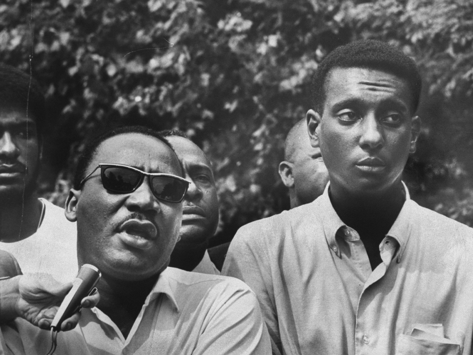 Martin Luther King Jr., shown here with Stokely Carmichael during a voter registration march in Mississippi in 1966, regarded the younger Carmichael as one of the civil rights movement's most promising leaders. (Lynn Pelham/Time )