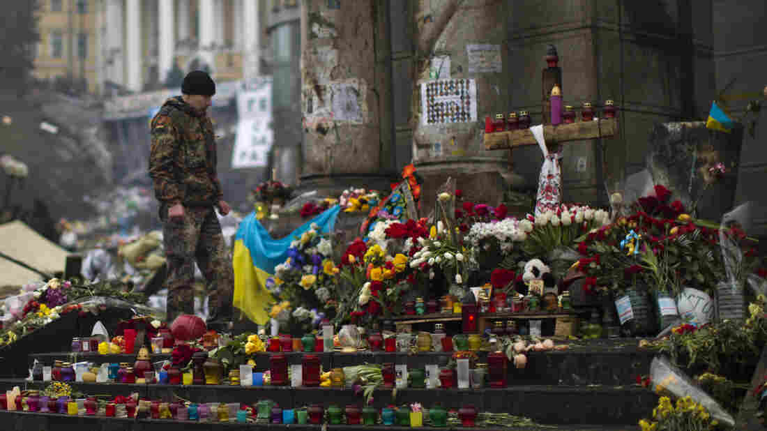 A Ukrainian protester stands at a memorial for the people killed in clashes at Kiev's Independence Square, on March 1. The focus of Ukraine's crisis is now in Crimea, where Russian forces are effectively in control.
