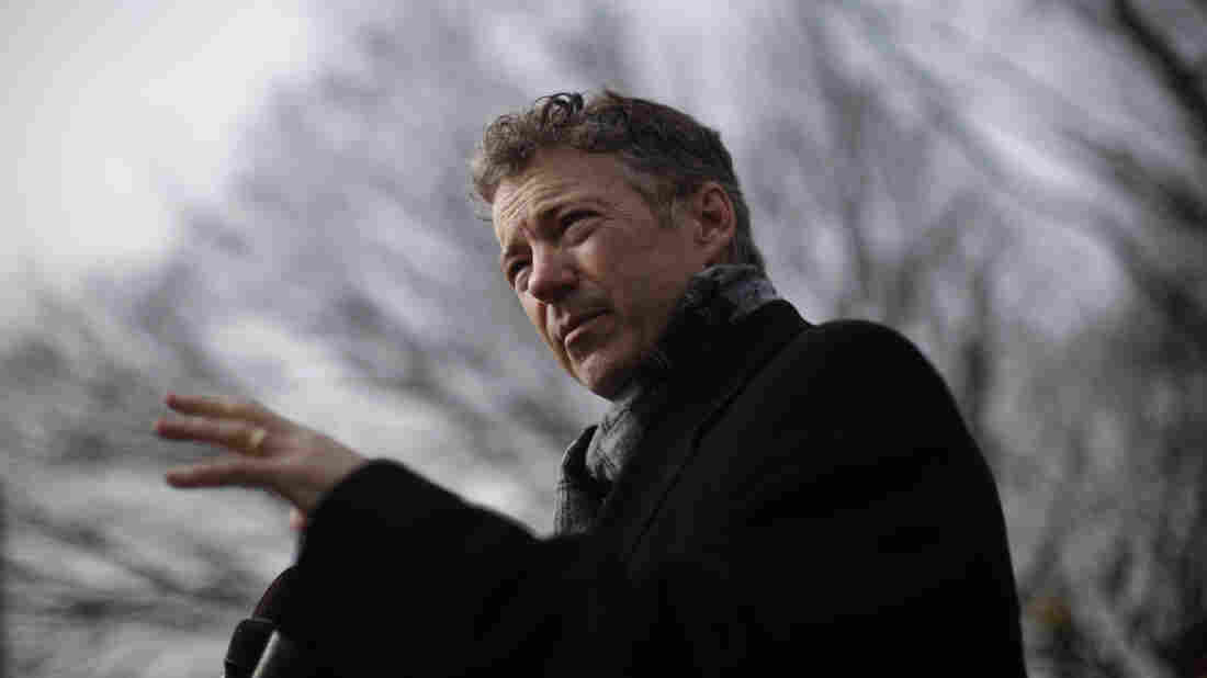 Sen. Rand Paul, R-Ky., speaks to reporters in front of federal court in Washington on Feb. 12.