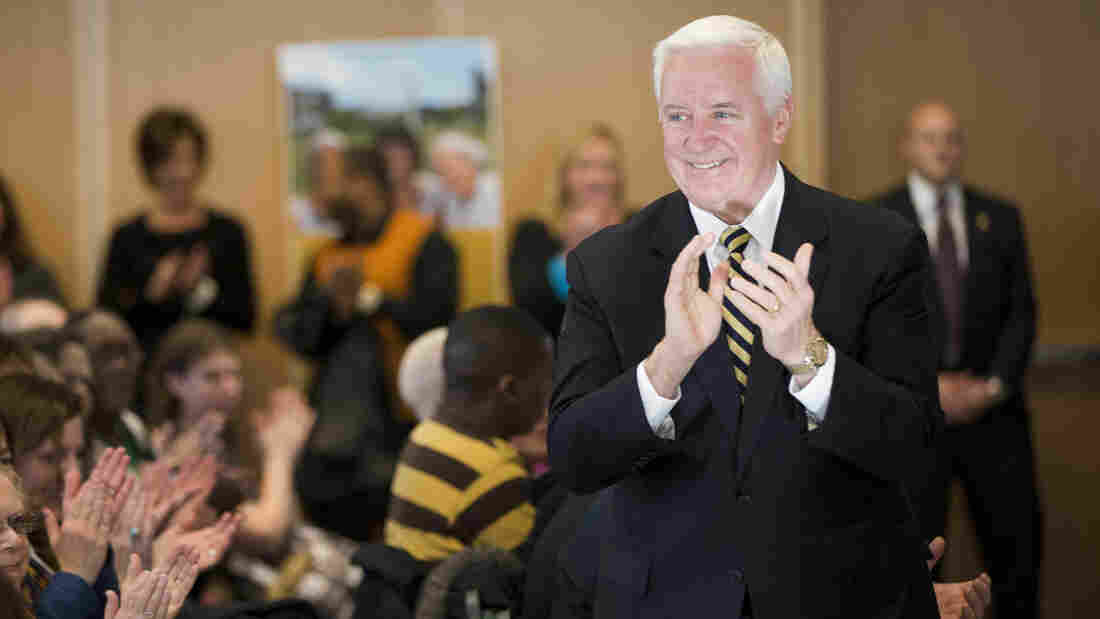 Pennsylvania Gov. Tom Corbett applauds a choir at The Salvation Army Ray and Joan Kroc Corps Community Center during a Jan. 29 news conference in Philadelphia.