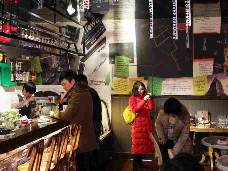 Plot lines adorn the walls of 221B Baker Street, a Sherlock Holmes-themed coffee shop in Shanghai.