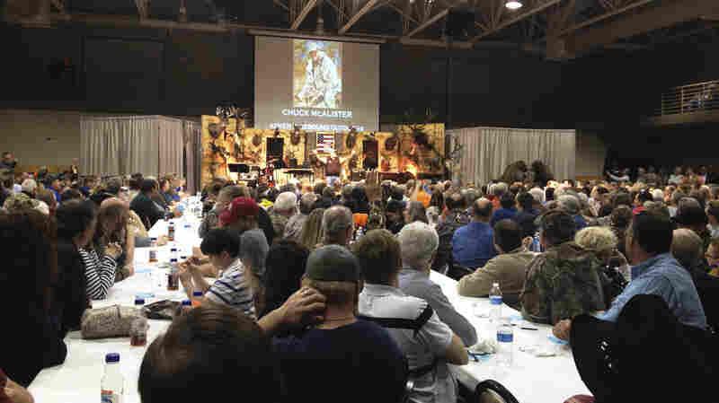A crowd of 1,300 talks guns, God and politics at a steak dinner and gun raffle at Lone Oak First Baptist Church in Paducah, Ky.
